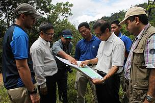 Discussing potential viaduct locations during a site visit with government agencies