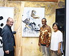 (From left) Mr Lee Khai, YBhg Dato' Dr Dionysius Sharma and Madam Cheong unveiling 'George the Dragon and Tiger' by Thomas Powell at the official opening of Art for Nature 2017.