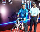 Bhg. Datuk Seri Ahmad Phesal, Mayor of Kuala Lumpur poses with a bicycle with Dato' Dr Dionysius S.K. Sharma, WWF-Malaysia Executive Director/ CEO.
