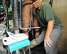 Dr. Zainal, the chief veterinarian of Borneo Rhino Sanctuary, conducting an ultrasound scan on a rhino to examine its reproductive condition.
