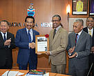 Chief Minister of Sabah receiving the Leaders for a Living Planet award certificate from WWF-Malaysia CEO