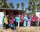 Puan Zainun Nur Abdul Rauf (centre) together with members of PEWANIS in Kampung Mangkuk, Setiu, Terengganu