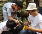 WWF-Malaysia Freshwater Management and Conservation Officer Mohd Khairulazman Sulaiman (right) showing some of the children how to carry out oxygen level test on river water.