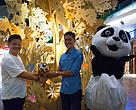 Yeap Chong Wei, WWF-Malaysia General Manager of Marketing (left) presents a token of appreciation to Ko Chai Huat, Mid Valley Megamall Director of Design, at the Mid Valley Megamall forest and tiger themed exhibition.
