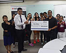 Rakesh Sarpal (left) with his students presenting the cheque to Dr. Mark Rayan at the cheque presentation at INTI International College Subang.